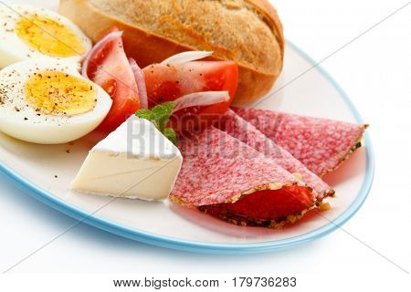 Breakfast - boiled eggs. ham and cheese sandwich