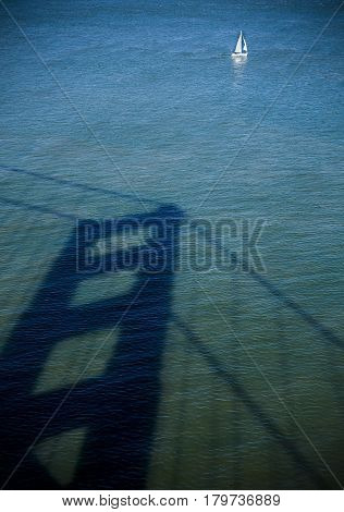 Shadow on the water bridge golden gates san francisco US and yacht