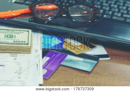 Finance concept : debt or bankruptcy , money and credit cards used for payment