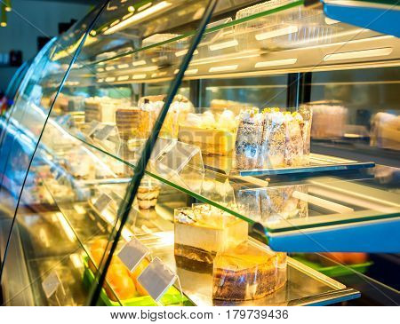 Cakes behind glass in a coffee shop