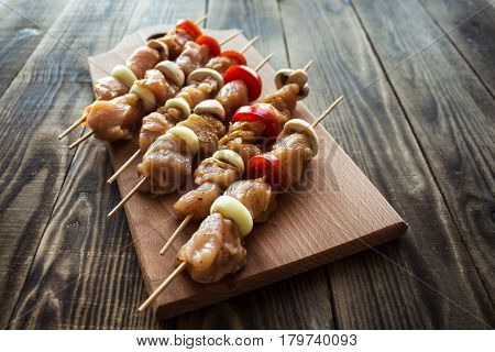 chicken shish kebab with tomato and mushroom barbecue on wood