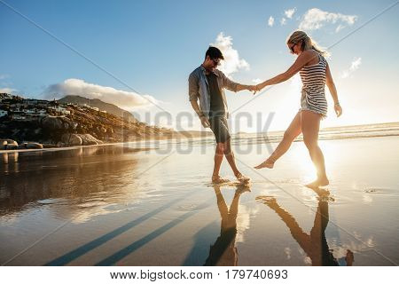 Beautiful Young Couple Playing On The Shore