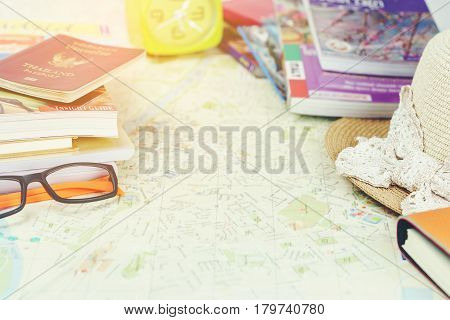 Traveling concept : Passport city maps eyeglasses woven hat books