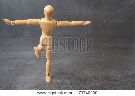 balancing wooden mannequin, puppet, with copyspace for creative concepts