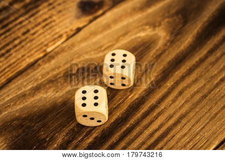 a wood dice on wooden background on six