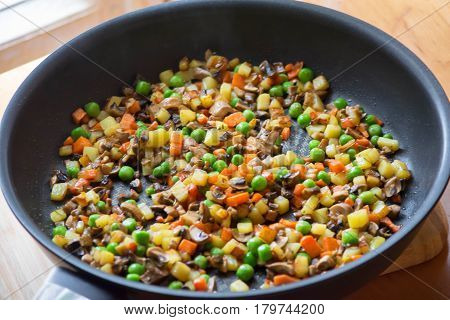 Bright vegetables fried in a frying pan