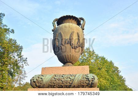 Vase in neoclassical style on Moskovsky Avenue in Saint Petersburg at sunny summer evening.