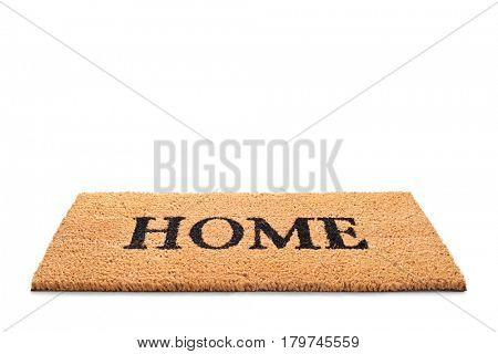 Doormat with the word home written on it isolated on white background