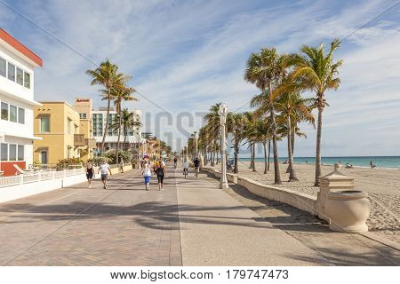 Hollywood Beach Fl USA - March 13 2017: People strolling at the Hollywood Beach Broad Walk on a sunny day in March. Florida United States