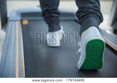 legs running on treadmill exercise at fitness center or gym