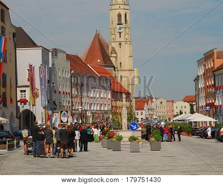 Neuoetting,Germany-May 26,2016: People take part in a procession on Corpus Christi day