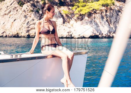 a young fashionable woman on her catamaran