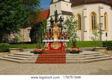 Altoetting,Germany- May 26,2016: An altar covered with flowers after an open air mass on Corpus Christi day in the town of Altoetting in Bavaria