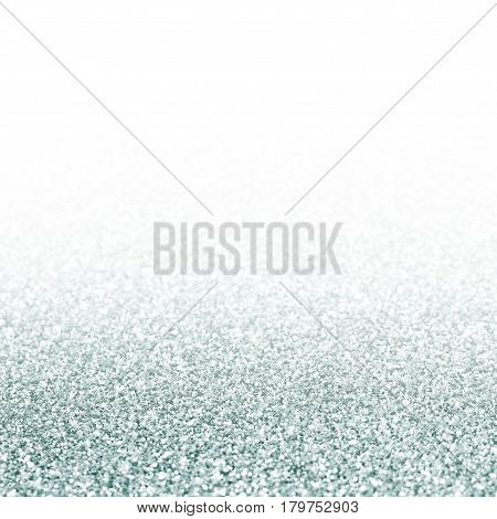 Shiny silver background with sparkles and flares.