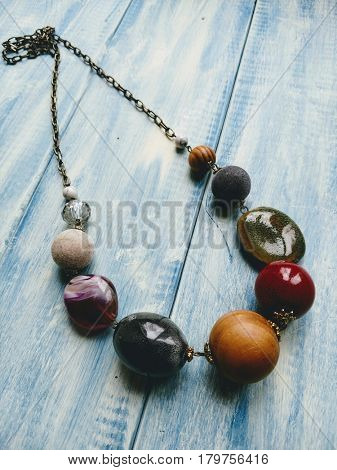 Colorful beaded necklace with a beautiful handcrafted wooden background