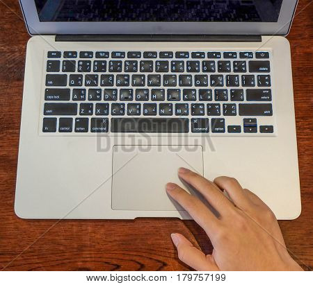 Woman office worker is using touch pad