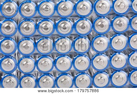 background from large group of blue batteries