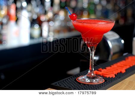 Red cocktail in a martini glasses