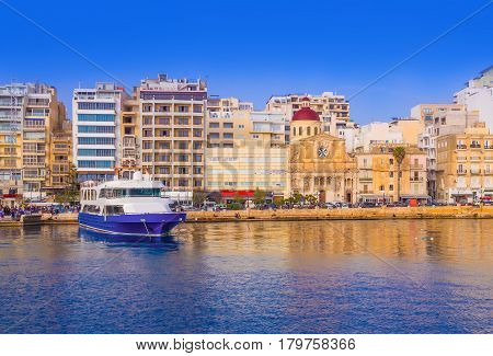 Beautiful panoramic view over the famous harbor of Valletta illuminated by sunset light, in Malta