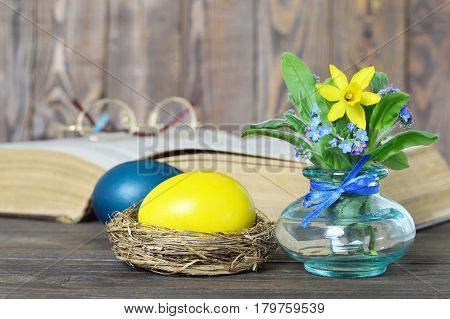Easter card with Easter eggs and spring flowers in the vase