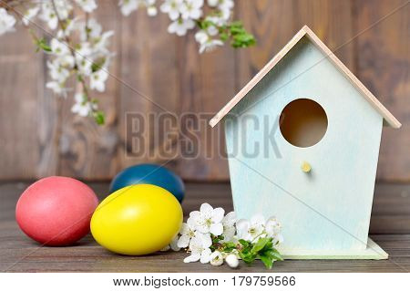 Easter card with Easter eggs birdhouse and spring flowers