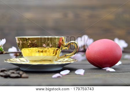Easter breakfast with Easter egg and cup of tea