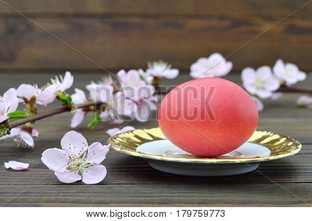 Happy Easter card with red Easter egg on the plate and spring branches
