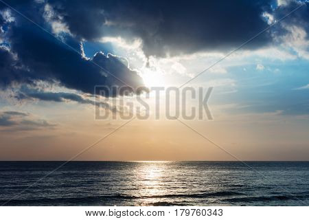 sunset over the ocean and clouds