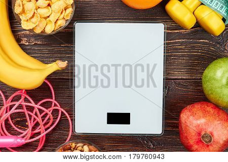 Scales, skipping rope and fruits. Balance is key to life.