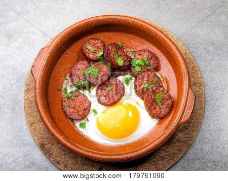 Fried spanish paprika pepper sausage with fried egg