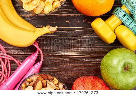 Bananas, apple and skipping rope. Healthy food and sport tools. Develop your willpower.