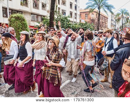ALGECIRAS SPAIN - MARCH 05 2017: Carnival participants singing and celebrating during the parade of the carnival in the street in Algeciras Cadiz Andalusia