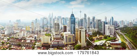 Panorama cityscape view in the middle of Kuala Lumpur city center early morning with little mist Malaysia .