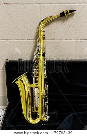a saxophone resting before the start of marching band rehearsal