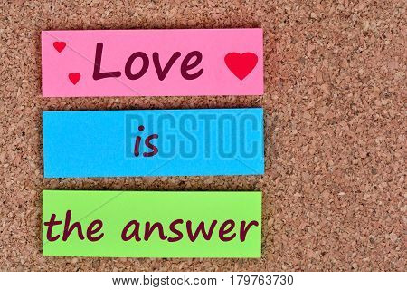 Text Love is the answer on colorful notes
