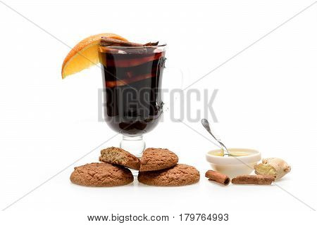 Glass Of Red Mulled Wine With Cookies And Honey
