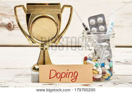 Syringe, pills and award. Stimulation of physical activity.