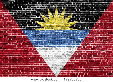 Flag of Antigua Barbuda painted on brick wall, background texture