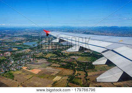 Airplane Flying Above Green Fields