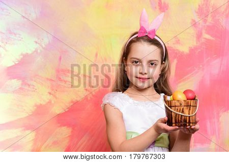 Small Happy Baby Girl Holding Bucket With Easter Eggs