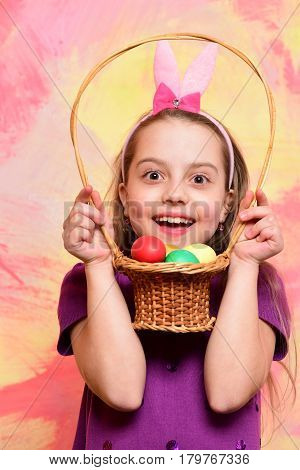 Small Happy Baby Girl Holding Basket With Easter Eggs