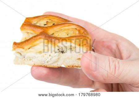 Piece Of Pie Stuffed In Male Hand Isolated On White