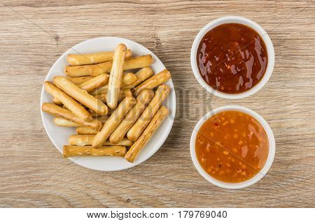 Bread Sticks With Salt In Saucer, Bowls With Sauces