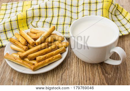 Bread Sticks With Salt In Saucer, Cup Of Milk