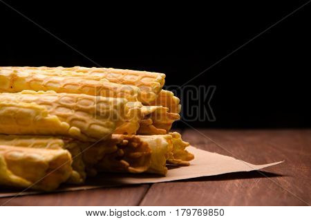 Tubular Wafer. Waffles On Wooden Boards. Waffles On Kraft Paper