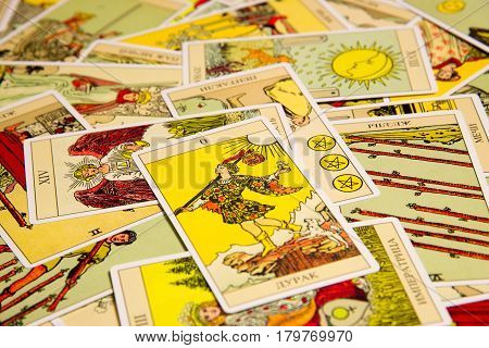 Moscow Russia - December 4 2016: Tarot card The Fool with other cards. Rider-Waite tarot deck. Esoteric background