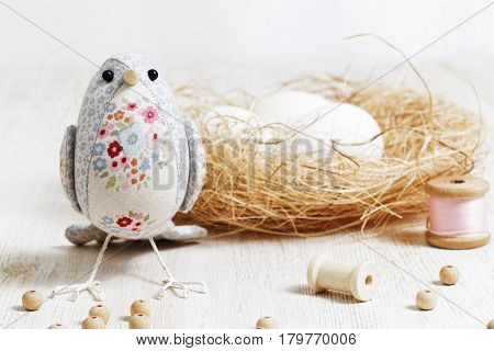 Handmade Bird Sewed From A Cloth Stands On A White Wooden Table