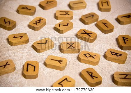 Wooden runes on the table. Esoteric subjects.