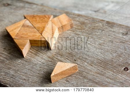 Wooden tangram puzzle wait to fulfill home shape for build dream home or happy life concept