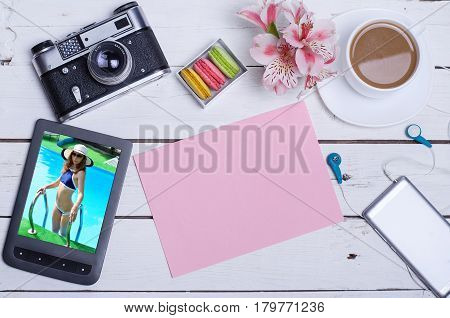 Old photo camera tablet a wooden table top view. The concept of summer recreation a cup of hot coffee on a wooden background.